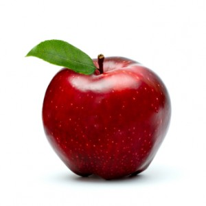 ripe red apple with green leaf isolated on white