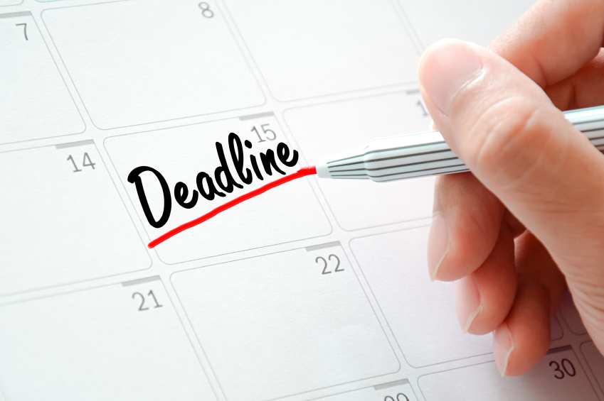 Deadline text on the calendar (or desk planner) underlined with red marker